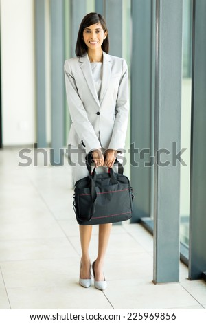 full length portrait of attractive business executive holding briefcase - stock photo
