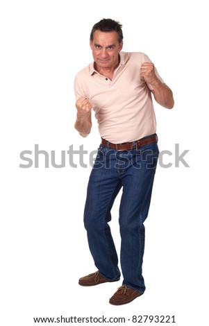 Full Length Portrait of Attractive Middle Age Man in Fighting Pose Ready to Punch