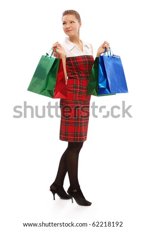 full-length portrait of beautiful blonde girl in checked dress with shopping bags on white