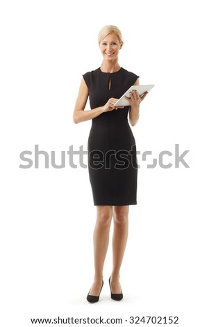 Full length portrait of beautiful business woman standing against white background.
