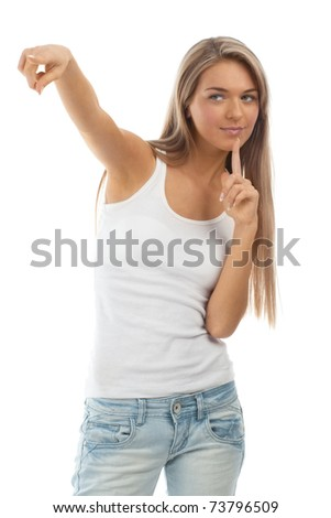 Full length portrait of beautiful casual girl pointing. Isolated on white background.