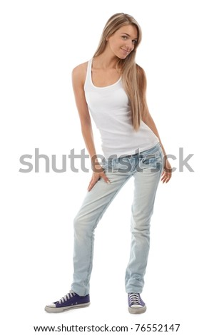 Full length portrait of beautiful casual girl posing and smiling. Isolated on white background.