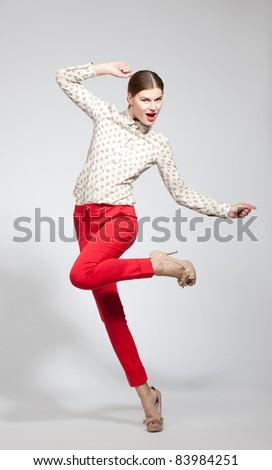Full length portrait of beautiful fashion model on white background - stock photo