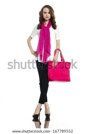 Full-length portrait of beautiful girl posing with red scarf posing in studio - stock photo