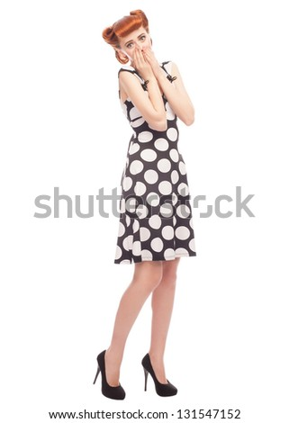 Full length portrait of  beautiful pinup woman looking surprised and covering her mouth. Isolated on white background - stock photo