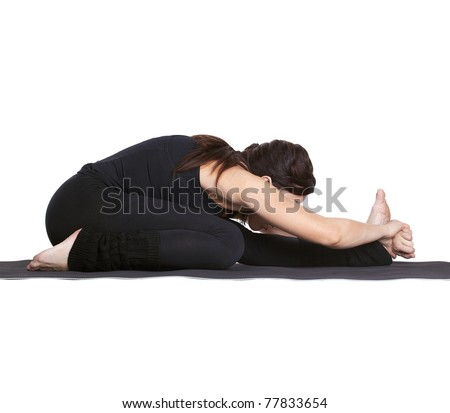 full-length portrait of beautiful woman working out yoga excercise janu sirsasana (head to knee forward bend) on fitness mat - stock photo