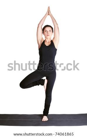 full-length portrait of beautiful woman working out yoga excercise tree-pose vrikshasana or vrksana - stock photo
