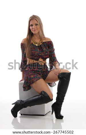 full-length portrait of beautiful young woman on colorful dress and black boots - stock photo