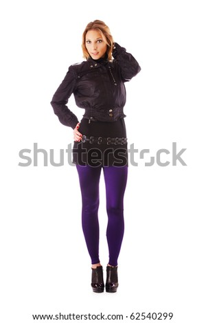 full-length portrait of blonde girl in black jacket and violet leggins on white - stock photo