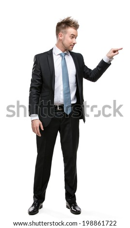 Full-length portrait of business man pushing something who wears suit with blue tie, isolated on white