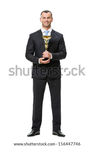 Full-length portrait of business man with gold cup, isolated on white. Concept of leadership and success - stock photo
