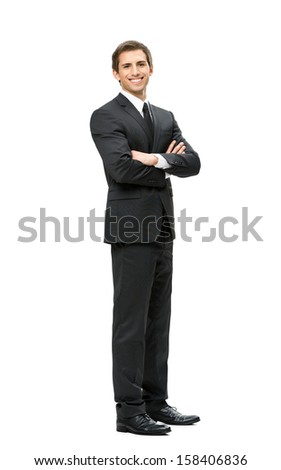 Full-length portrait of business man with hands crossed, isolated on white. Concept of leadership and success - stock photo