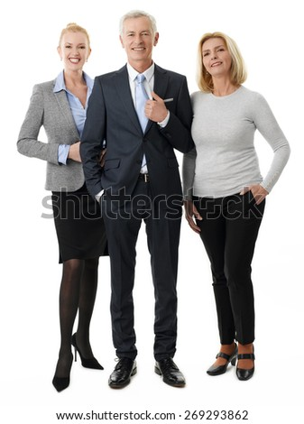 Full length portrait of business people standing against white background. Efficiency businesswomen and senior businessman looking at camera and smiling.  - stock photo