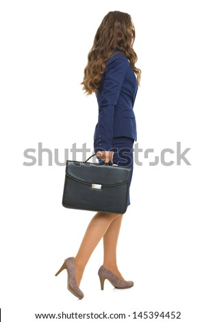 Full length portrait of business woman with briefcase going . rear view - stock photo