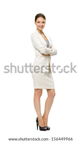 Full-length portrait of business woman with her hands crossed, isolated on white. Concept of leadership and success - stock photo