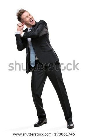 Full-length portrait of businessman shoving something who wears suit with blue tie, isolated - stock photo