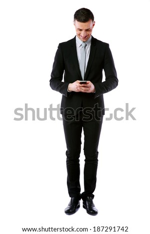 Full-length portrait of businessman using smartphone over white background