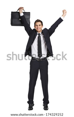 Full-length portrait of businessman with hands up who holds briefcase, isolated on white. Concept of business and success - stock photo