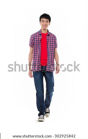 Full length Portrait of casual man in jeanswalking in studio - stock photo