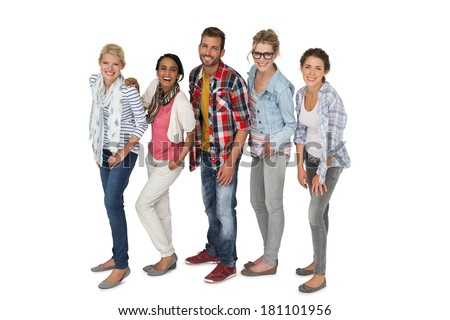 Full length portrait of casually dressed young people over white background - stock photo