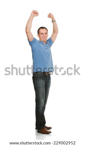 Full length portrait of cheerful man with arms raised standing against white background - stock photo