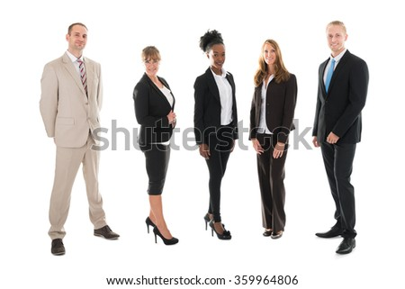 Full length portrait of confident business team standing against white background - stock photo