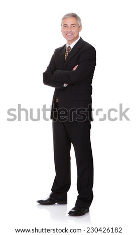 Full length portrait of confident businessman with arms crossed isolated over white background - stock photo