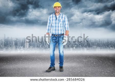 Full length portrait of confident handyman against road - stock photo