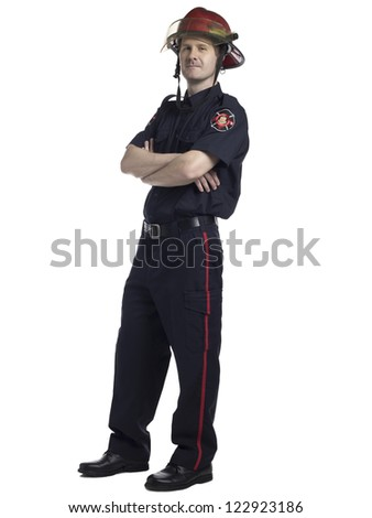 Full length portrait of confident male fire fighter standing against white background - stock photo