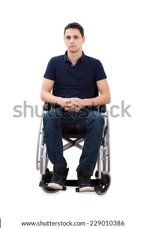 Full length portrait of confident man sitting with hands clasped in wheelchair isolated over white background - stock photo