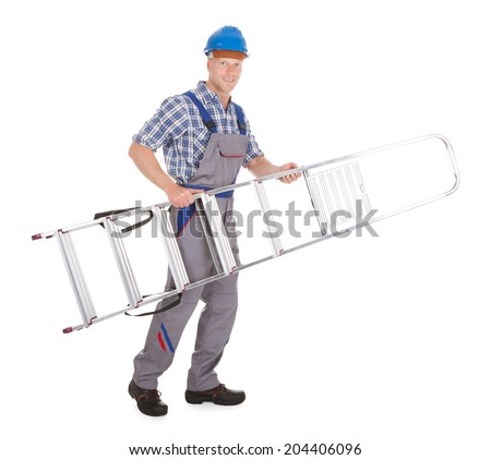 Full length portrait of confident manual worker carrying step ladder over white background - stock photo