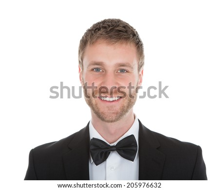 Full length portrait of confident waiter standing hands behind back over white background - stock photo