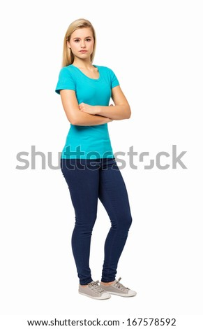 Full length portrait of confident young woman isolated over white background. Vertical shot. - stock photo