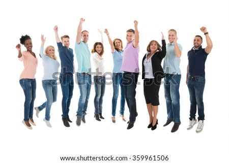 Full length portrait of creative business team celebrating success against white background