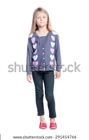 Full length portrait of cute little girl looking at camera. Isolated on white. - stock photo