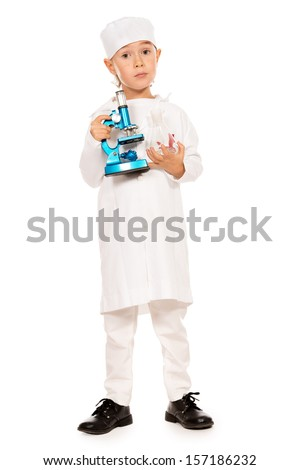 Full length portrait of cute smiling boy playing a doctor with microscope. Different occupations. Isolated over white. - stock photo