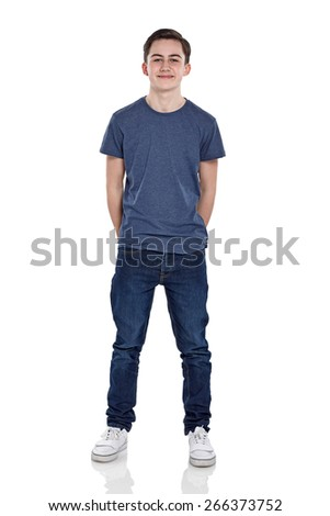 Full length portrait of cute young boy looking at camera smiling on white background  - stock photo