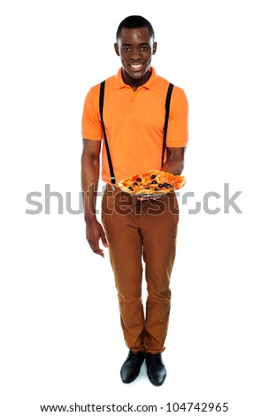Full length portrait of delivery boy with pizza isolated over white