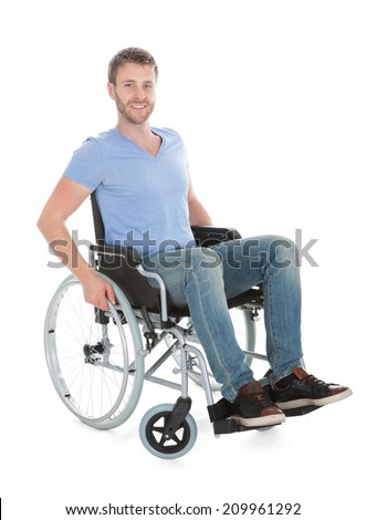 Full length portrait of disabled man on wheelchair over white background - stock photo