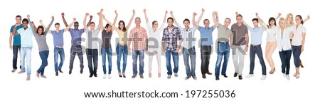 Full length portrait of diverse people in casuals celebrating success against white background - stock photo