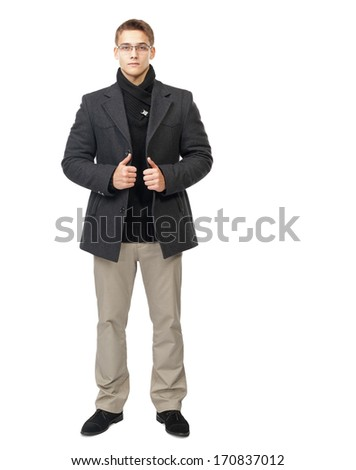 Full length portrait of elegant young man wearing grey coat, white pants and glasses isolated on white background