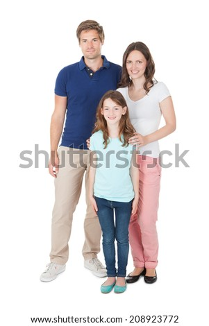 Full length portrait of family in casuals standing over white background - stock photo