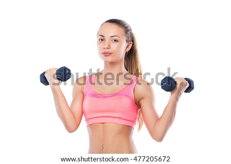 Full length portrait of fitness young woman with dumbbells.