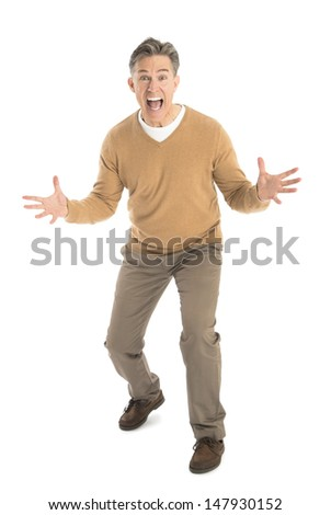 Full length portrait of frustrated mature man screaming while standing isolated on white background - stock photo