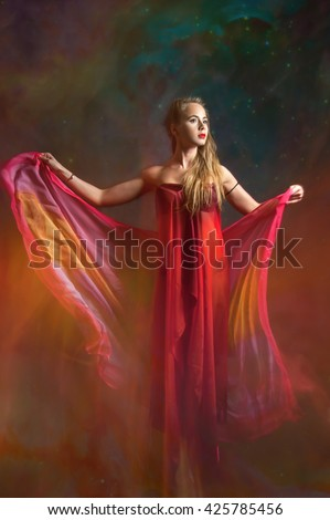 full length portrait of girl in red on universe background. studio shot in mixed light