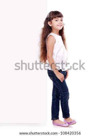 Full length portrait of girl leaning on the blank board