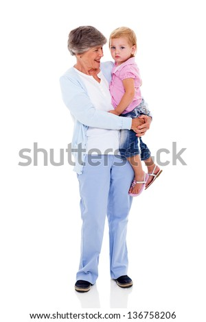 full length portrait of grandmother carrying her grandchild isolated on white - stock photo