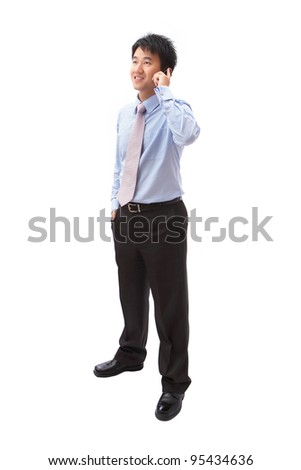 full length portrait of handsome business man speaking mobile phone isolated on white background, model is a asian - stock photo