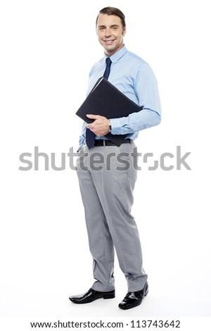 Full length portrait of handsome confident businessperson holding file folder - stock photo
