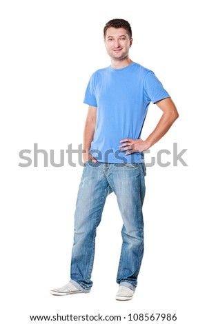 full length portrait of handsome man in t-shirt and jeans. isolated on white background - stock photo